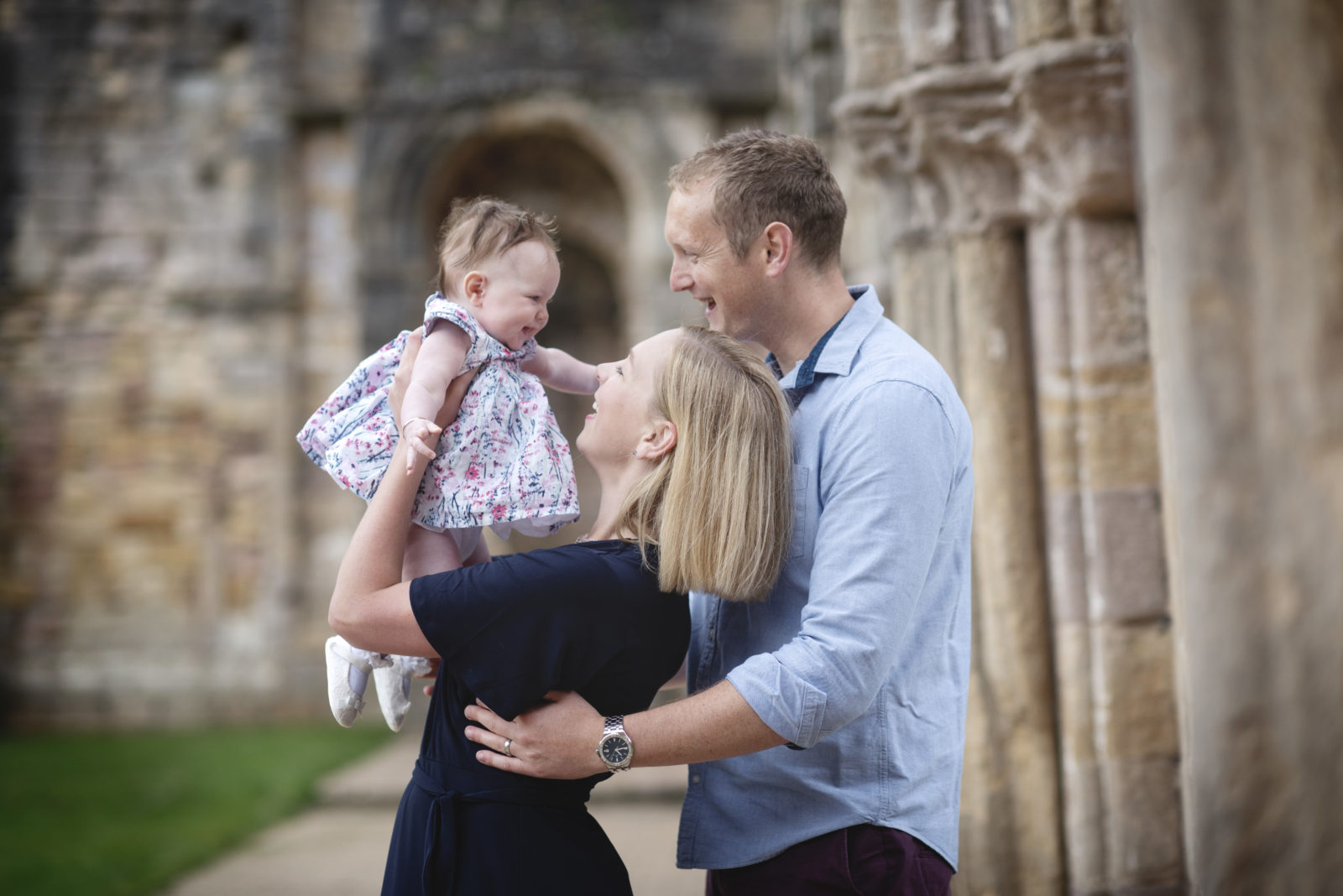Couple with baby at naming ceremony